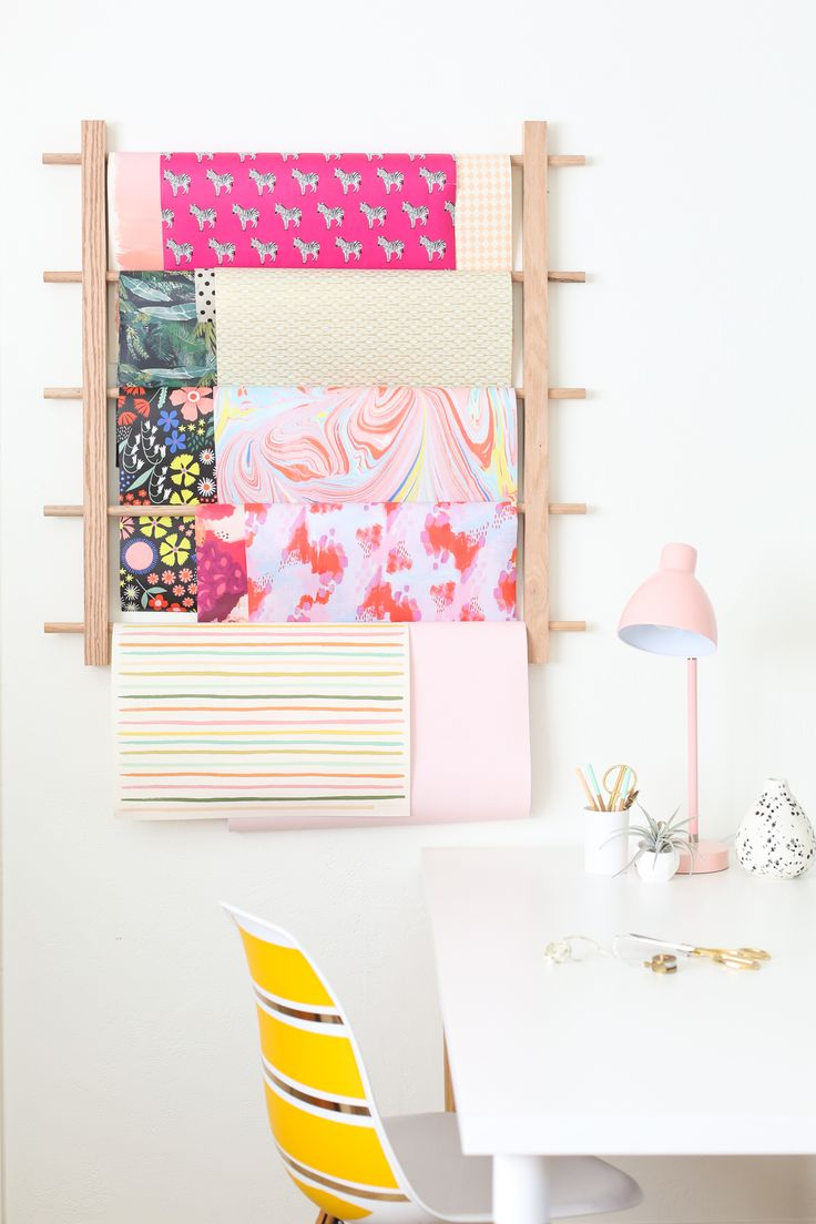 How to Make a Hanging Organizer for All Your Wrapping Paper. How to make a simple ladder to hang all of your decorative wrapping paper, no more mess!