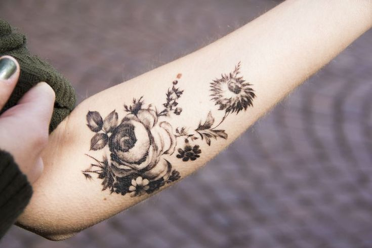 black and white floral tattoo.