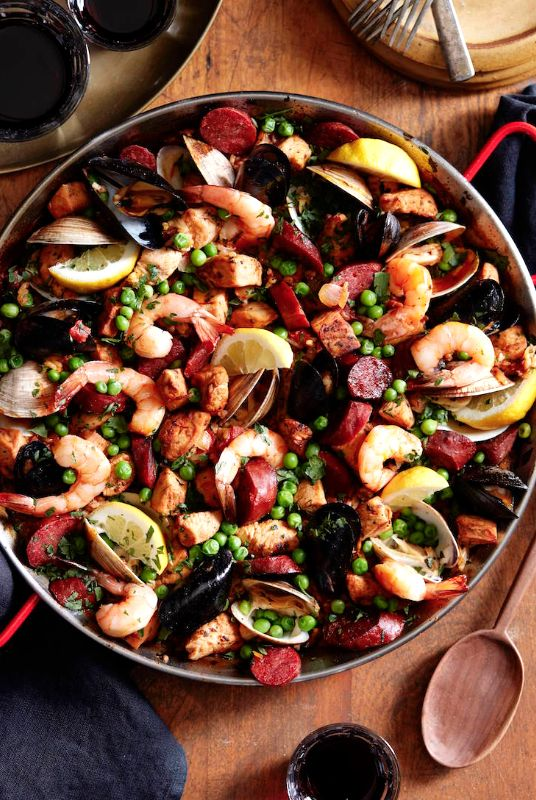 The best Spanish Paella loaded with shrimp, clams, mussels, chorizo and chicken from www.whatsgabycooking.com (@whatsgabycookin)
