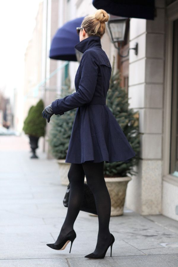 Winter Fashion Street Style- love the peplum flair in her black coat with black high heel pumps