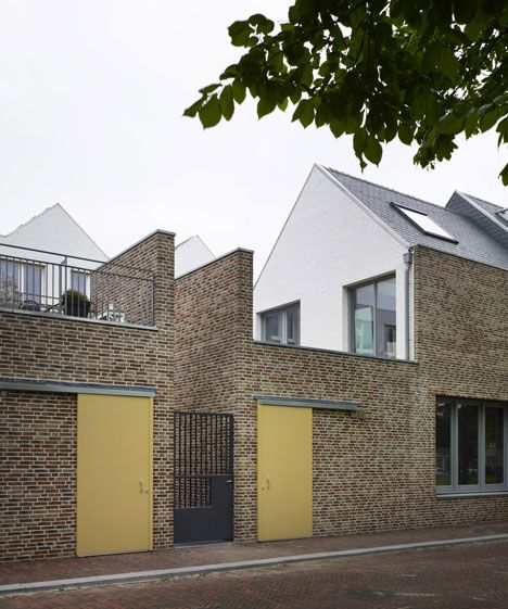 http://www.dezeen.com/2013/05/21/houses-in-molenplein-by-tony-fretton-architects/