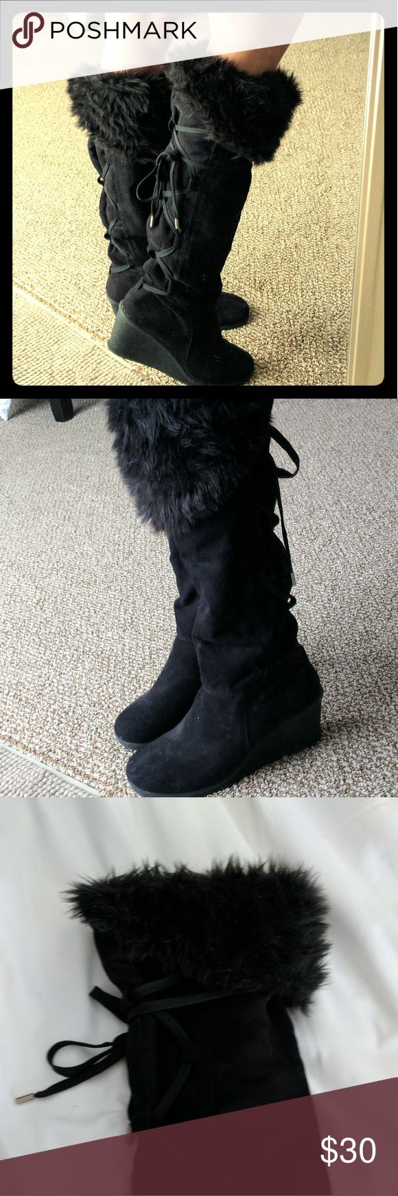Wedge boots Super cute black wedge boots. Theses boots are the best of both worlds with cute and comfort. They have a furry top cuff and lace up the back. They are slip on boots, there is no zipper. Only worn a few times so they are still in great condition. Decree Shoes Heeled Boots
