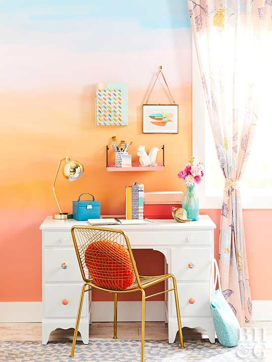 Try an organic take on crisp stripes with this painted wall that blends colors in horizontal bands. Inspired by a photo of a sunset, the wall features several coral shades and a blue finish that represents the sky.