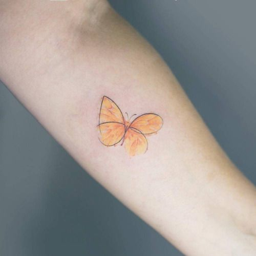 Sketchy yellow butterfly tattoo on the left inner forearm....