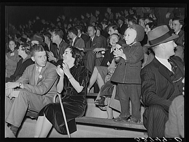Some University of North Carolina students on their campus in Chapel Hill, Orange County, North Carolina, with their weekend guests and many of the townspeople at a pep rally the night before the Duke-North Carolina game, which was played in the Duke Stadium in Durham, North Carolina