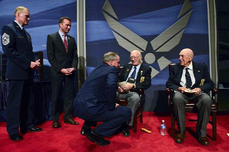 Chief Master Sgt. of the Air Force James A. Cody, left, Acting Secretary of the Air Force Eric Fanning and Chief of Staff of the Air Force Gen. Mark A. Welsh III speak to The Doolittle Raiders after their final toast at the National Museum of the U.S. Air Force Nov. 09, 2013 in Dayton, Ohio. (U.S. Air Force photo/Desiree N. Palacios)