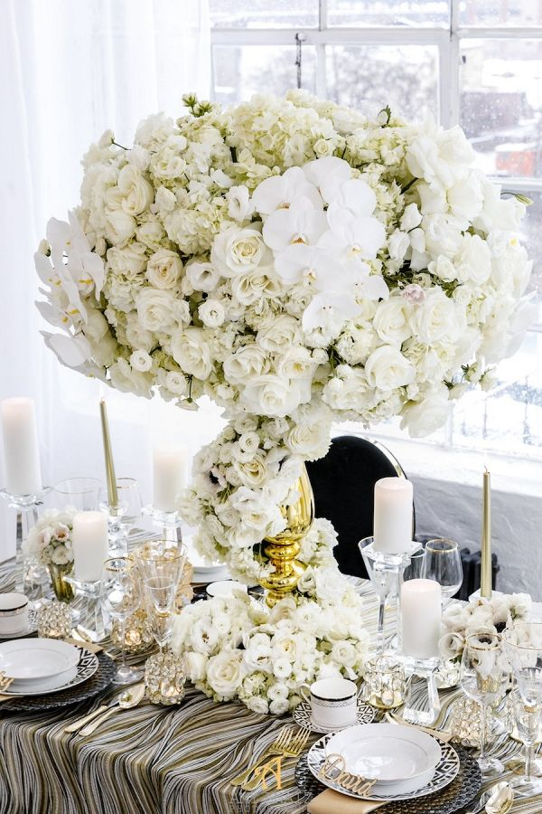 Tall White Wedding Centerpiece in Gold Vase | Amy Anaiz Photography on @AislePerfect via @aislesociety