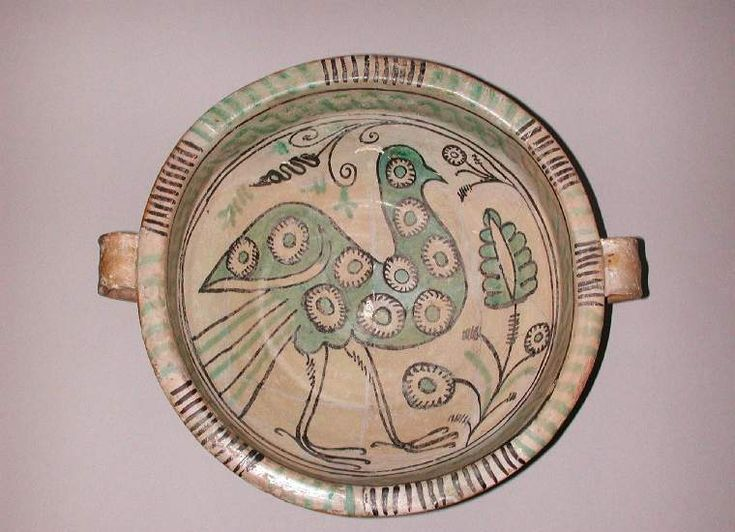 Maker(s): Unknown; pottery; possibly Unknown; pottery; possibly Category: tin-glazed earthenware Name(s): two-handled bowl maiolica; category maiolica arcaica; category Date: circa 1275 — 1375 School/Style: maiolica arcaica Period(s): 13th Century; 14th Century; Medieval