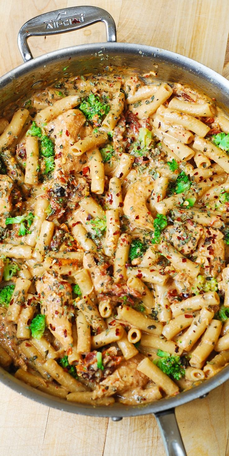 Chicken and Broccoli Pasta with Sun-Dried Tomato Cream Sauce: short, penne pasta smothered in a flavorful, creamy sauce spiced up with garlic, sun-dried tomatoes, basil and crushed red pepper flakes! A taste of Italy!