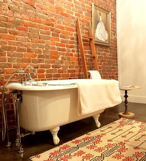 ladder for storage: Cool Bathroom, Expo Brick Wall, Clawfoot Tubs, Dreams Bathroom, Towels Racks, Master Bath, Exposed Brick, Interiors Design Blog, Concrete Floors