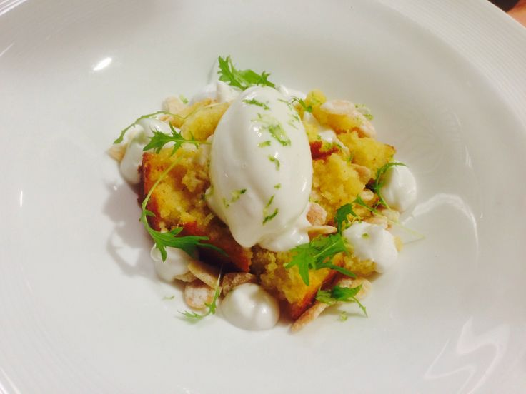 A new dessert of semolina pudding candied almonds , coconut crema and yoghurt sorbet
