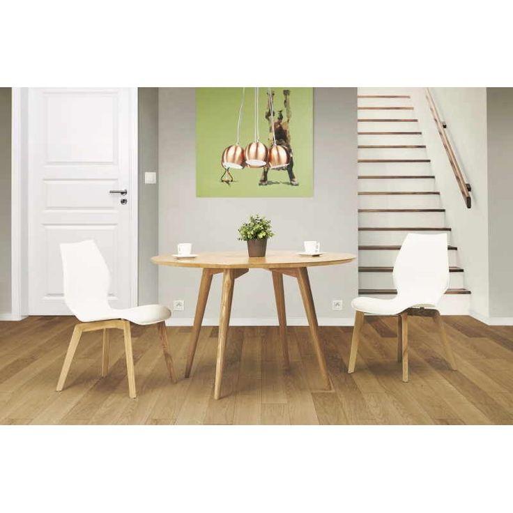 Table à manger style scandinave ronde PONY en bois pour un intérieur zen et épuré.
