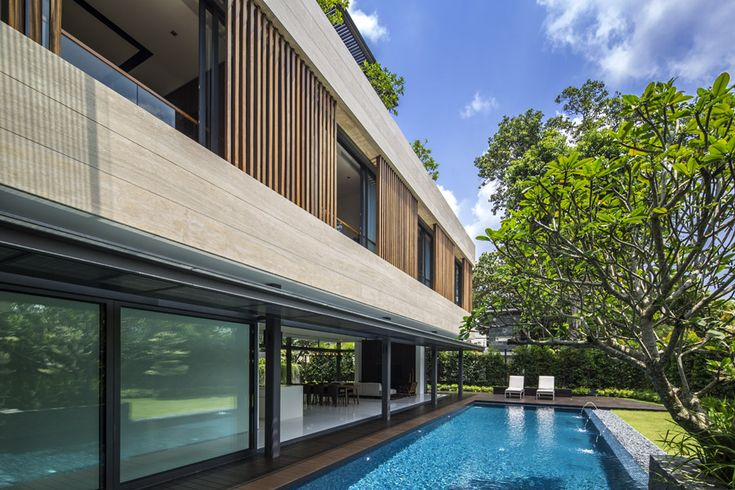 The secret garden house designed by singapore based wallflower architecture design is situated in the good class bungalow area of bukit timah