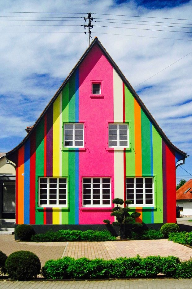 Multi-colored rainbow striped house in Eckartsweier, Baden-Württemberg, Germany
