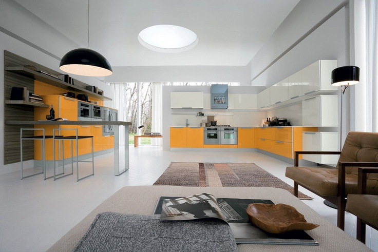 A lovely contemporary space, incorporating living, relaxing and cooking. Perfect for any modern home. #kitchen #yellow #contemporary #white #modern