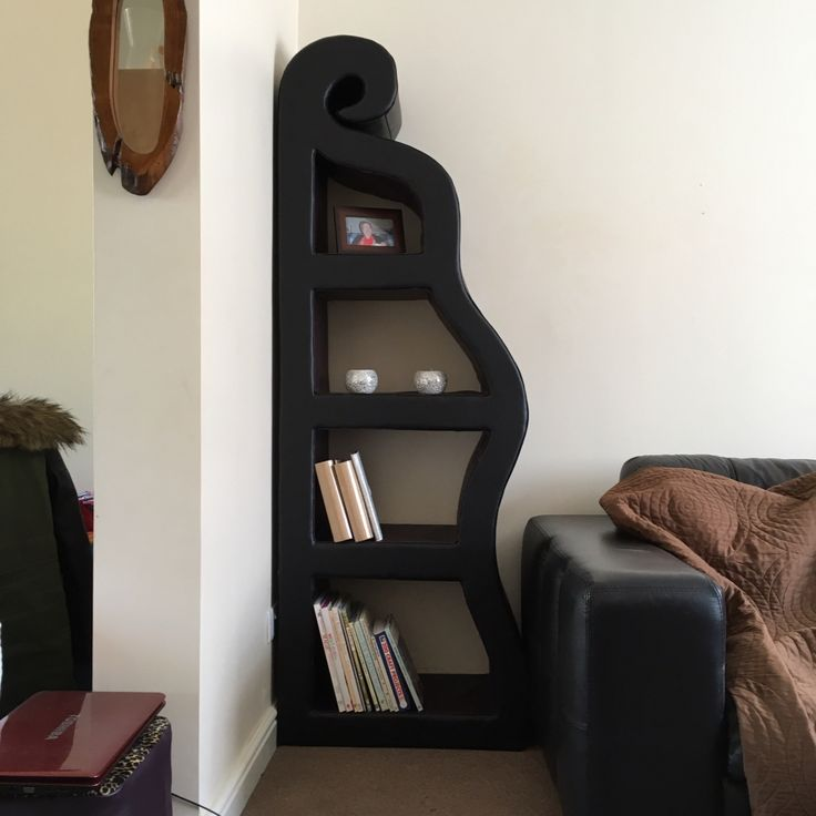 Cardboard book shelf covered in vynal