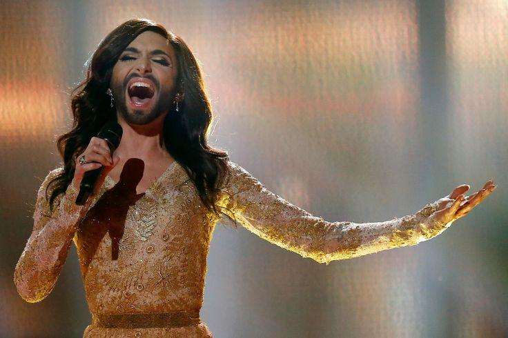 """Winner, Conchita Wurst, singing """"Rise Like A Phoenix"""" at Eurovision 2014."""