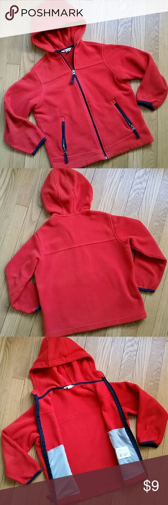 Size 7 Lands' End kid fleece jacket Size 7 kids' fleece jacket with hood, made by Lands' End. * Midweight fleece (not super thin or very heavy). * In good condition. No holes or marks; zippers all in good working order; just some overall signs of wash and wear. * Orange red color, with navy blue trim. Could be worn by boys or girls. * 16-1/2 inches, armpit to armpit, when zippered closed. 18-1/2 in, from top of shoulder to bottom of jacket (see last pic).   ** Price is firm unless bundled…