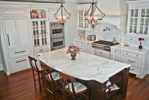 Traditional Kitchen with Chandelier, Arbor White Carrera With Black Dot Marble Tile, Inset cabinets, Complex marble counters