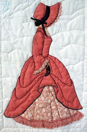 "#14 ""Bonnet Girl Relatives & Friends"" Marilyn $6.50 (included in the Tearoom also).   Marilyn in her red applique dress is showing off her Victorian under skirt in this picture. She has a black ribbon on her red bonnet with gloves to match. Ruffled lace trims the sleeve."