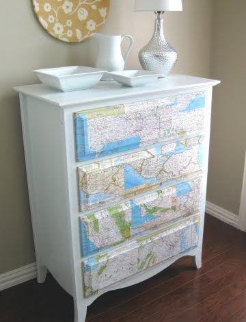 Kristin of Domestic Ease was given some old National Geographic maps and created a  Map Decoupage Dresser with them. She applied a thin coat of Mod Podge, then positioned the paper.