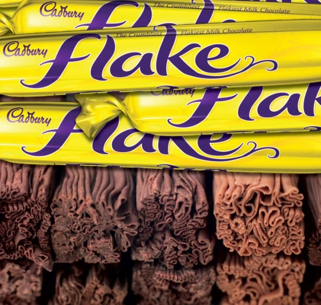 The 'Flake' chocolate bar was first developed in 1920. An employee of Cadburys noted that when the excess from the molds used to create other chocolate bars was drained off, it fell off in a stream and created folded chocolate with flaking properties. In 1930, Cadbury started producing a smaller version of the standard Flake bar especially for ice cream cones. These were marketed under the name 99 Flake and sold loose in boxes rather than individually wrapped like the traditional Flake.