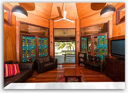 Comfortable lounge area opening onto the large screen enclosed verandah