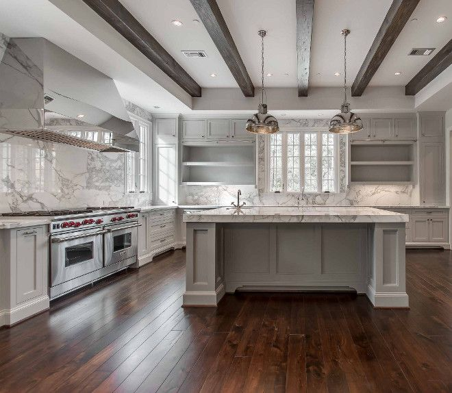 love the movement in the full marble backsplash think i would have gone with a - Kitchen Hood Ideas