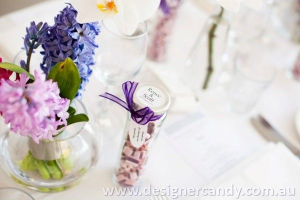 Thank you to Renee & Scott for sending in these photos from your big day! Renee & Scott ordered custom coloured heart candy in purple & mauve to match the floral arrangements. All the best guys x  #weddingcandy #designercandy #bomboniere #favours Credit to Connie's Magic Moments - Custom Photographer for the photos https://www.facebook.com/ConniesMagicMomentsCustomPhotography?fref=ts