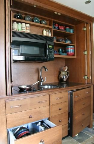 I just love these little hide awasy armoire kitchens! Armoire Mini-Kitchen | YesterTec Kitchen Design Company