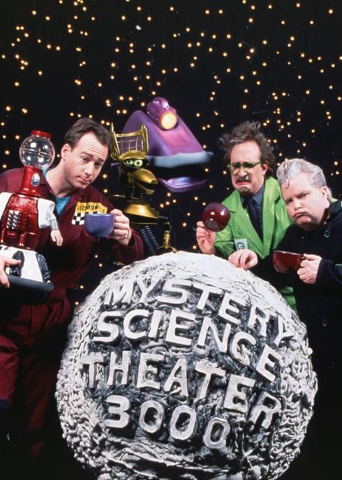 The gang's all here: Joel Hodgson, left, and his robot pals pose with mad scientists Clayton Forrester and Frank Conniff.