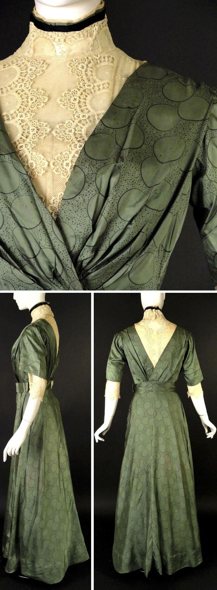 Day dress, ca. 1912. Green silk with black circle pattern. Overlapping bodice falling to gathers at center front. Ivory lace & net neckline; stand collar. Black & green silk ribbon borders top of collar. Cummerbund at waist with flat bow on side. Slender skirt falls from natural waistline seam with small box pleat down left front side. Short, set-in sleeves end with turned-back cuffs and lace & net under sleeves. Boned bodice lined in ivory taffeta. Vintage Martini