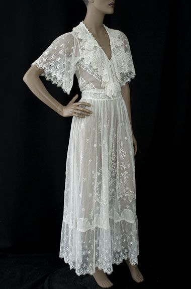 Irish crochet/embroidered tulle tea dress, c.1912. The deeply cut armholes and full sleeves are quite comfortable. The pattern on the skirt features high relief, padded satin stitch embroidery. I can see a gracious hostess in this tea dress: nothing could be more perfect than the costume; pure ivory, but the fashion consummate; a single rose her only ornament.