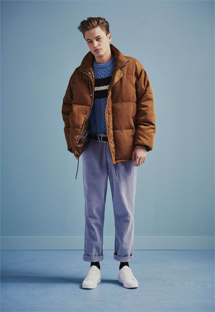 Denis channels relaxed 90s style in a down jacket, cable-knit sweater, and high waist trousers from River Island.