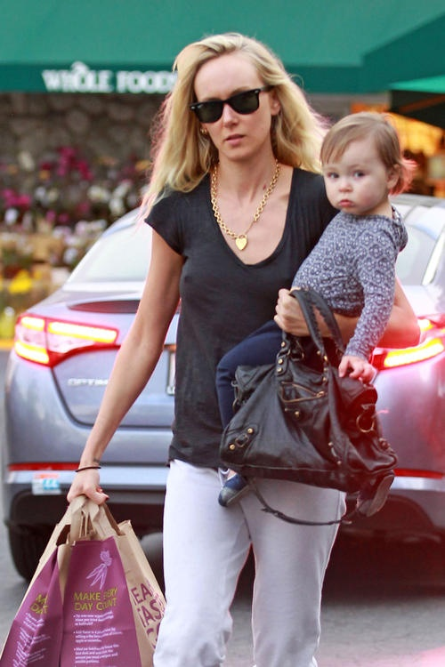 Kimberly Stewart has her hands full with daughter Delilah and grocery bags on her way out of Whole Foods in Los Angeles