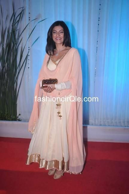 Former Miss Universe and actress Sushmita Sen wearing off white and peach Anarkali from Shilpa Reddy Studio at Esha Deol's reception in Mumbai