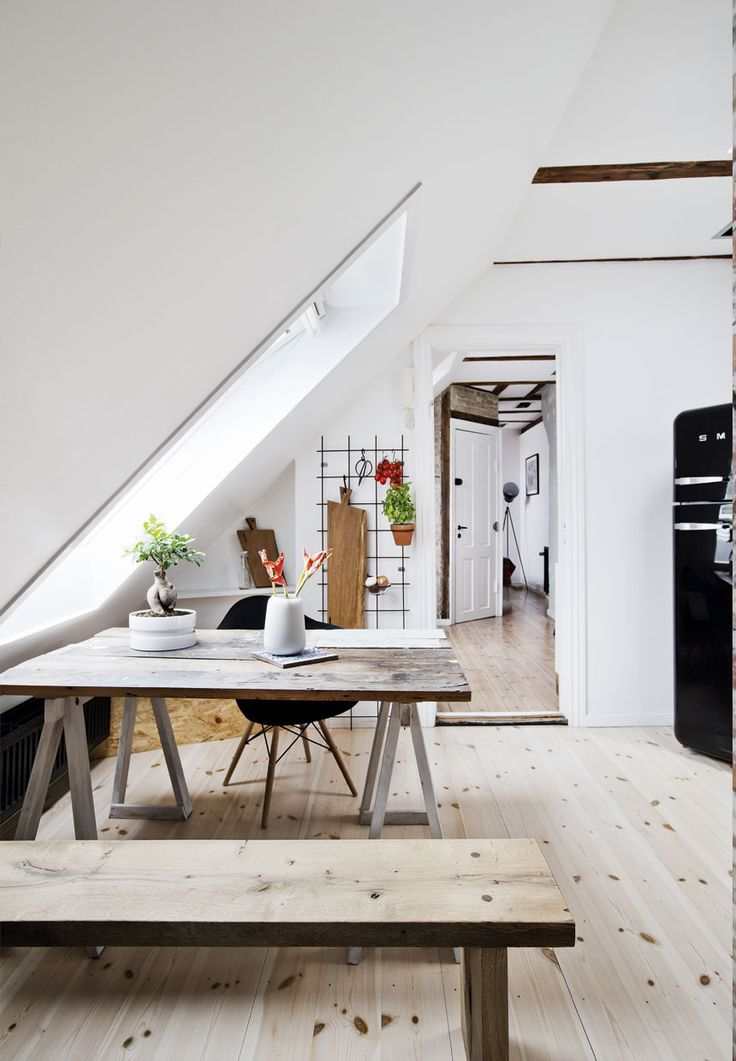 Chic apartment with exposed brick and reclaimed wood details #attic