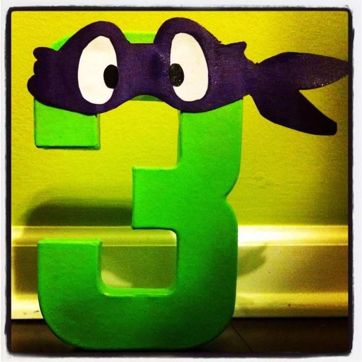 Painted paper mache number with ninja turtle mask.