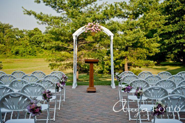 Wedding Ceremony Decor anyafoto.com #wedding, outdoor wedding, outdoor wedding ideas, wedding ceremony decor ideas, bows on pews, white folding chairs, spring flowers, wedding arch
