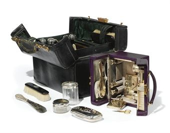 AN ASPREY PURPLE-LEATHER VANITY CASE AND A MAPPIN & WEBB BLACK-LEATHER VANITY CASE