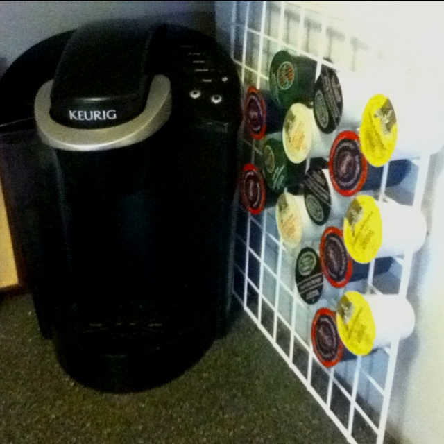 Easy K-cup holder  Take a grid from a cube shelf. Put in K-cups. Free your counter space. ;)
