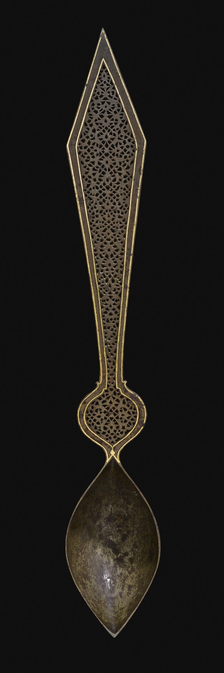 A QAJAR PIERCED AND ENGRAVED GILDED SPOON, PERSIA, 19TH CENTURY of typical form, the arm pierced and with a gilded border, the body of the spoon with detailed engraving composing foliate motifs and lobed cartouche gilding 48.5cm.