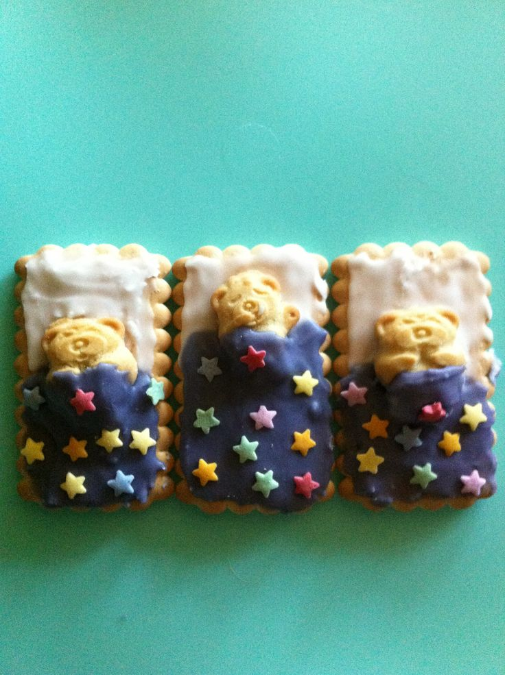 Tiny Teddy biscuits in bed. Easy to create tiny teddy biscuits with arrowroot or similar, regular icing and a few little decorations.