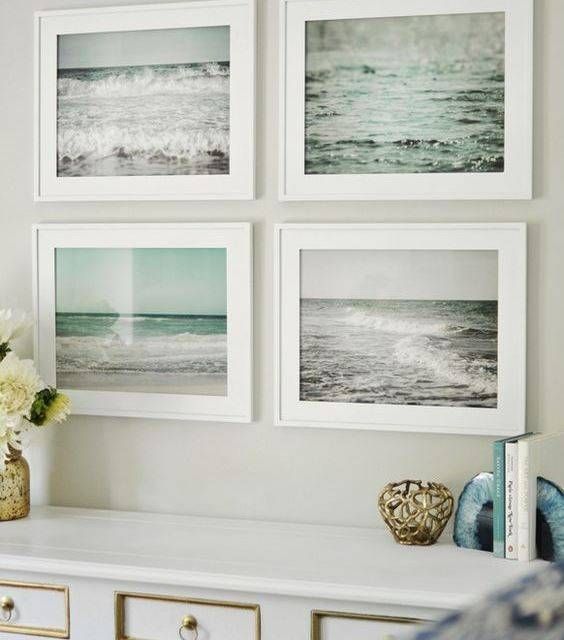 Just some of your favorite photos can bring a bit of summer into your home. Ocean Themed Decor Interior Ideas | Domino