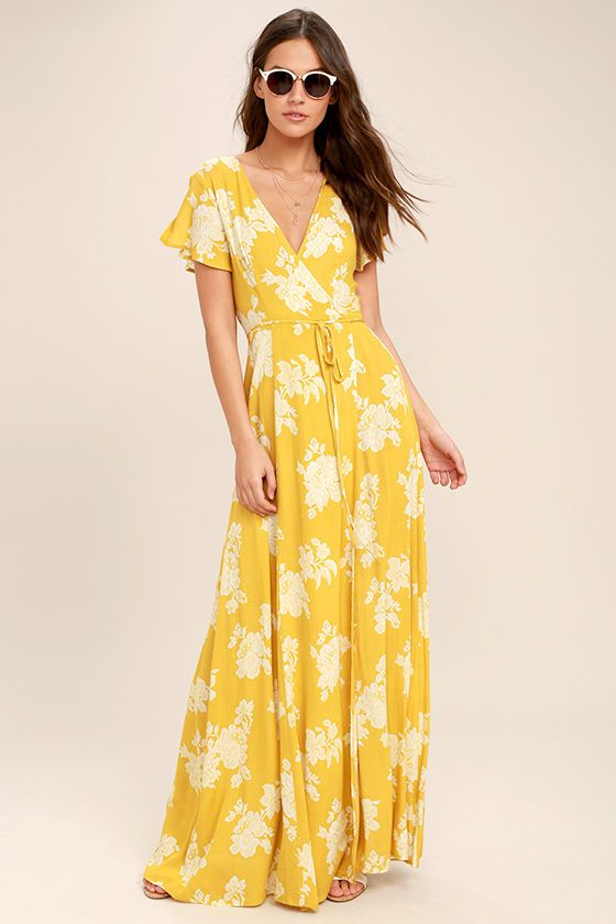 Lulus Exclusive! Win them over every time with the Heart of Marigold Yellow Floral Print Wrap Maxi Dress! White floral print embellishes breezy woven rayon as it drapes into a sultry surplice bodice, framed by fluttering short sleeves. Wrapping maxi skirt secures via hidden, internal ties and an adjustable waist tie.