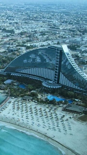 607 best odd unique shaped buildings images on pinterest for D shaped hotel in dubai