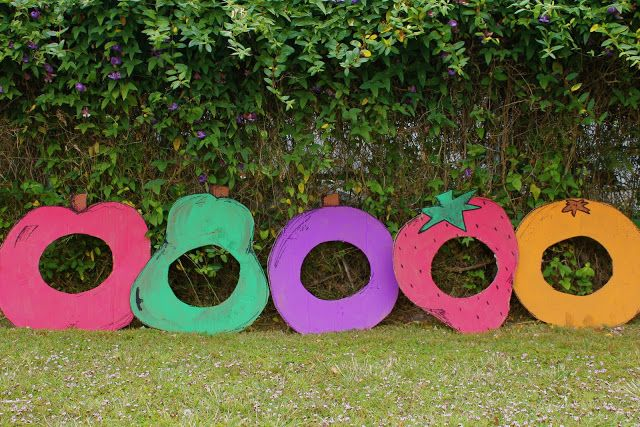 Very Hungry Caterpillar party. Cardboard boxes cut and painted to look like fruit. Kids can wear the fruit to reenact the story. Or cut smaller holes and use them for beanbag toss.