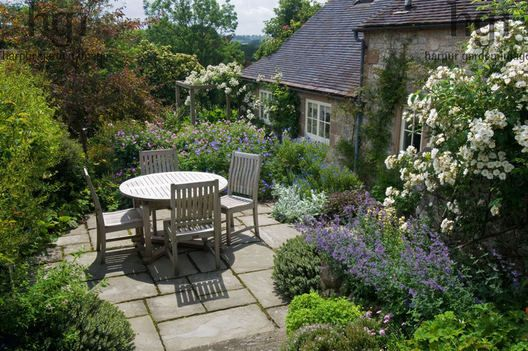 Harpur Garden Images Ltd :: slater96 Small terraced country garden house patio terrace paved area table and dining chairs outdoor living entertaining Nepeta Rosa rose pergola Geranium Design: David Stevens for Kevin Slater, Creamery Cottage, Parwich, Derbyshire, UK Jerry Harpur Small, terraced, country, garden, house, patio, terrace, paved, area, table, dining, chairs, outdoor, living, entertaining, Nepeta, Rosa, rose, pergola, Geranium, Creamery Cottage, Parwich, Derbyshire,, UK, Jerry…
