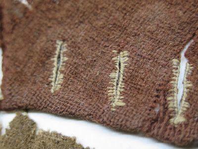 Medieval textile finds, Tartu Estonia. Buttonholes: silk on wool. Photo: Mervi Pasanen