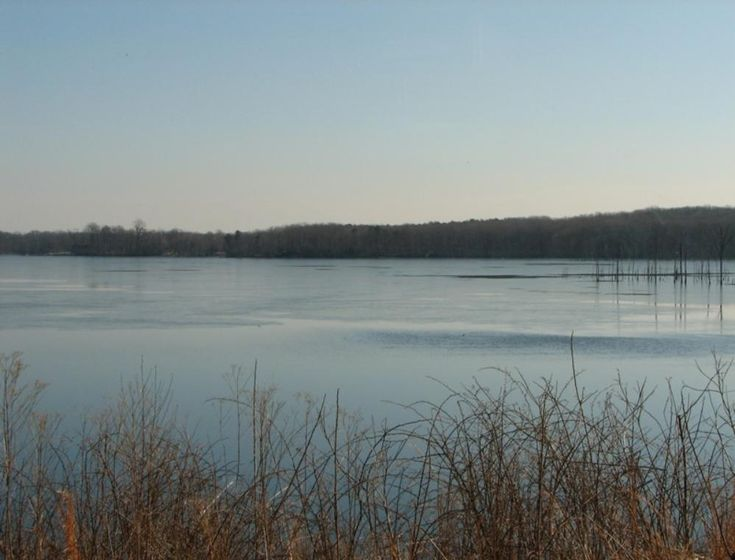 Manasquan Reservoir in Howell ~ The reservoir is an important part of the water supply in Monmouth County. Water from the Manasquan River enters and exits the reservoir through the inlet/outlet tower in the front of the main dam.